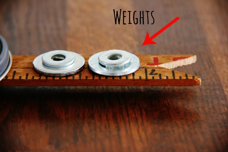 Attach weights to the back of the longer hand of the bicycle clock.