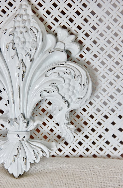 These white painted distressed accents for the bathroom add to the farmhouse decor.