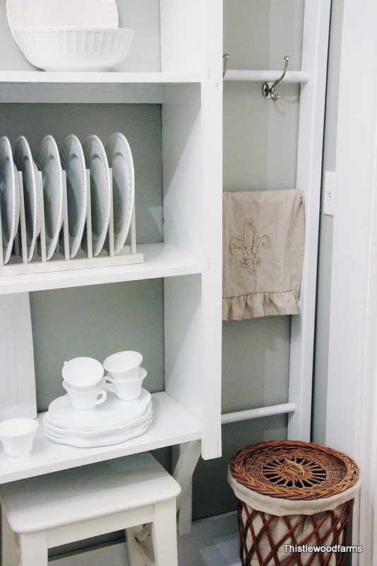 A display rack helps dishes and glassware stay organized in the butler's pantry.