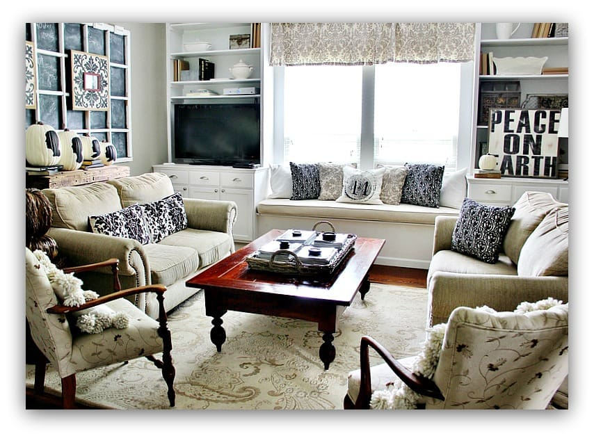 This elegant family room is neutral with pops of black for added drama to the decor.