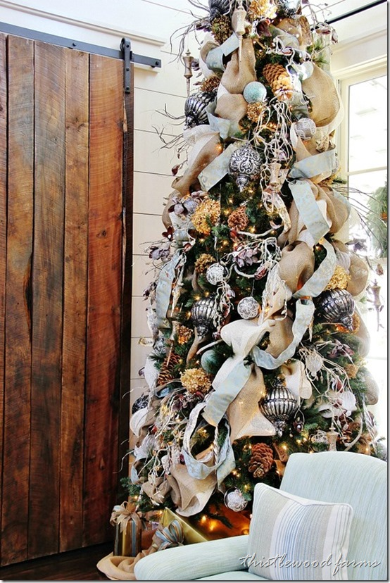 This southern style christmas tree is packed with ribbons and ornaments and dried hydrenga flowers
