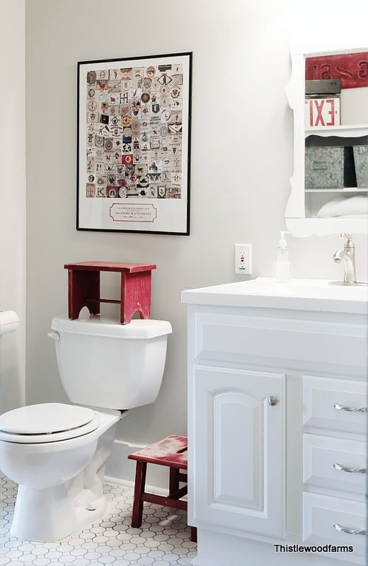 This bathroom with the old wallpaper removed looks more modern and updated.