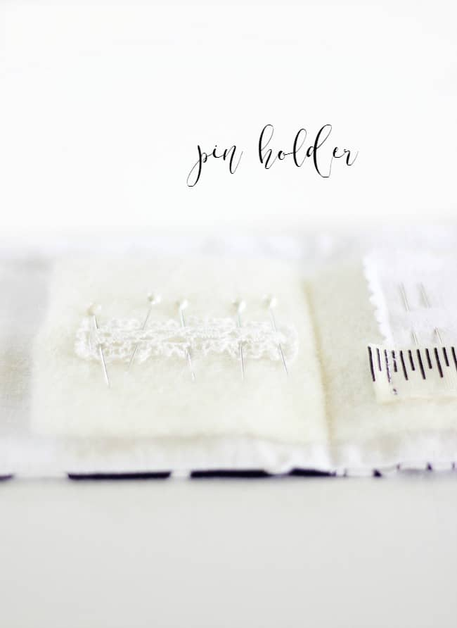 create a pin holder in your sewing book by gluing a small piece of lace to the inside cover