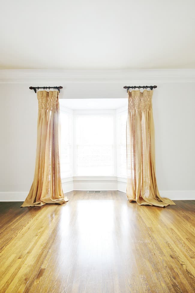 The front windows with long curtains
