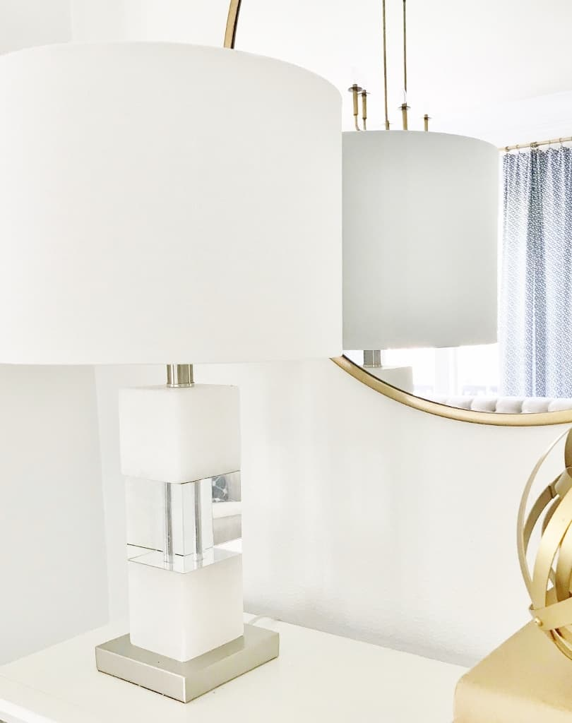 decorating with lamps and marble lamp base and white shade