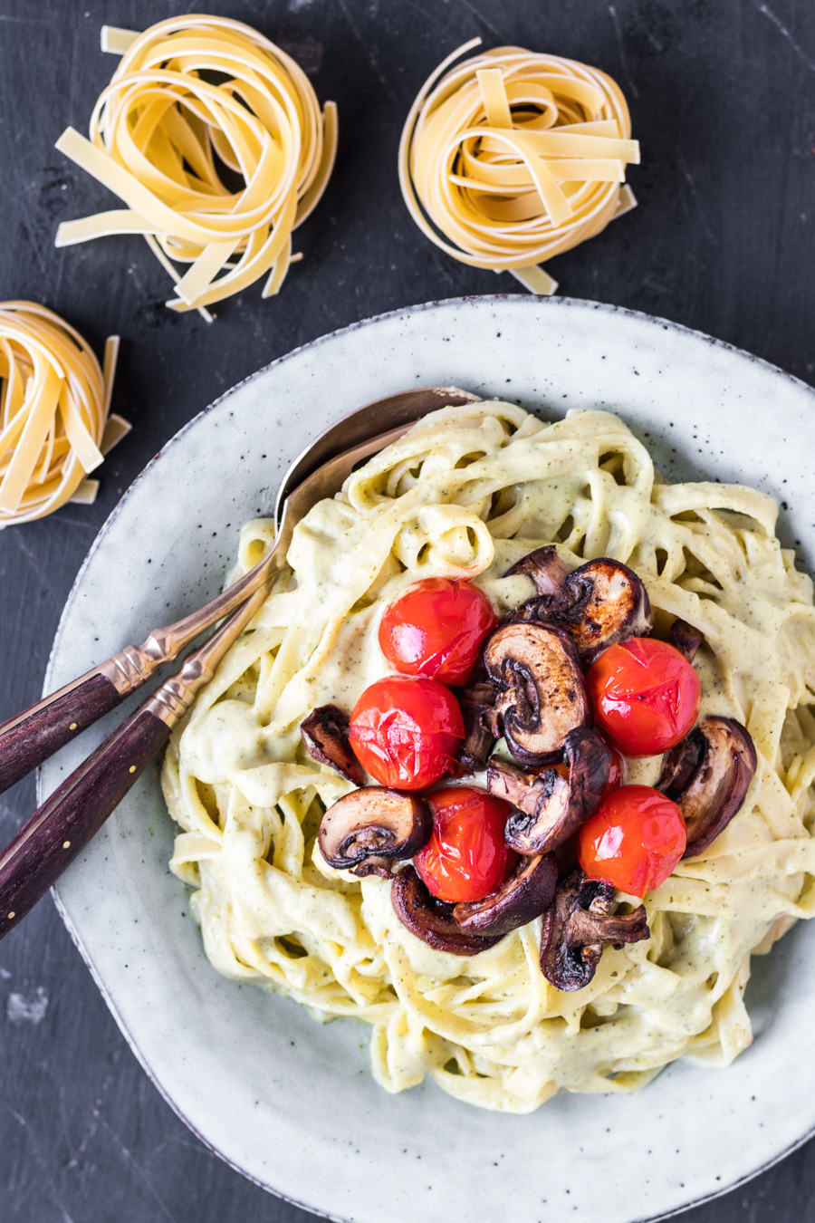Tagliatelle In Vegan Garlic Courgette Cream Sauce With Tender Chestnut Mushrooms & Roasted Cherry Tomatoes