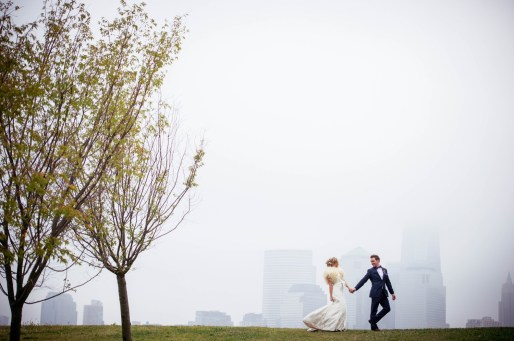 I make no secret of the fact that I love sunny days. I love using the bright, dramatic sun in my wedding portraits. On the day of this 2013 Maritime Parc wedding the sun never made a single appearance. The entire day was cloudy, damp, and with a mist hanging over the Manhattan skyline. During the portrait session of the bride and groom in Liberty State Park I actually adored the weather. What I wanted to be bright and vivid was quiet and muted. I love the dreamy, misty ambience of the images from this portrait session and I especially love the dreamlike appearance of Manhattan in the background of this photograph. Compressed away from the bride and groom by my use of the Nikon 70-200mm lens, the background takes on an almost watercolor look. While this doesn't reduce my love for the bright sunshine it does strengthen my affection for cloudy days!