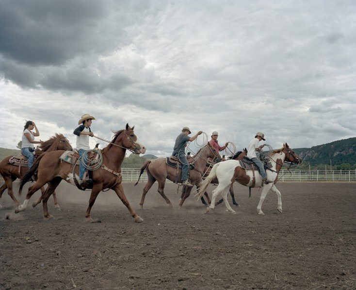 Native youths and teens warm up before competing at the children's rodeo at the Wasay Wakpa Wachi Powwow in Lodgepole Montana. Children on the Rez are practically born on horseback; many learn to ride shortly after they learn to walk. Children are allowed to ride far distances unsupervised. They hang out with their friends on horseback and are allowed to use them for mobility the way urban kids might hang out on bikes or skateboards.