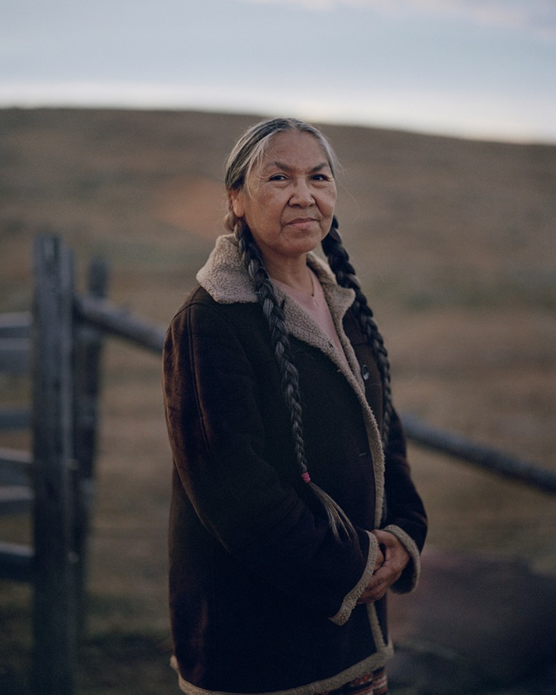 Ranita Longknife in-front of her small Horse paddock outside of the Fort Belknap Agency. Often owned Family land is far away from any settlement so it is not connected to any power or water supplies. This devalues the land significantly.