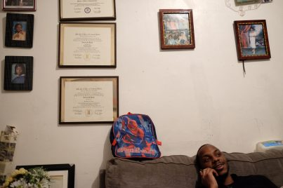 Bronx, NY Oct. 12, 2014 Diplomas and graduation photos hang on the wall of the Harris residence. Travis was not able to finish college because the music program at his school was defunded due to budget cuts. Photo by M.B. Elian