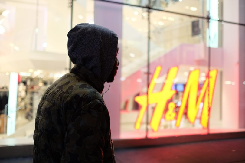 New York, NY Oct. 12, 2014 Travis Harris, 25 year old freelance cinematographer, walks passed his night job at flagship H&M store in Times Square after working the graveyard shift the ends at 4am. Photo by M.B. Elian
