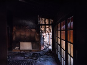 A home where the bedroom only caught fire, the fire crew came to put it out and as a result the rest of the home has fire damage and is covered in black soot.