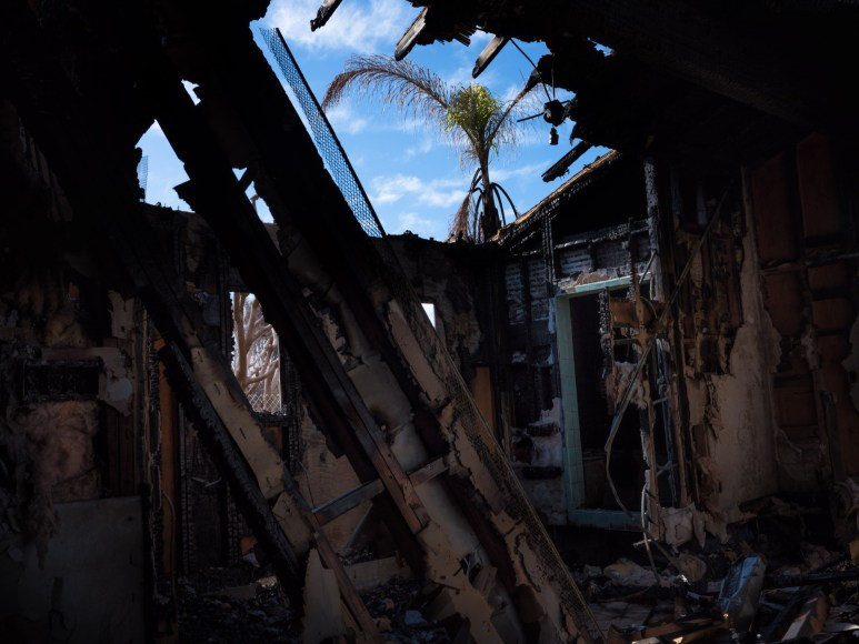 A view of a bedroom that caught fire, the fire crew managed put it out.