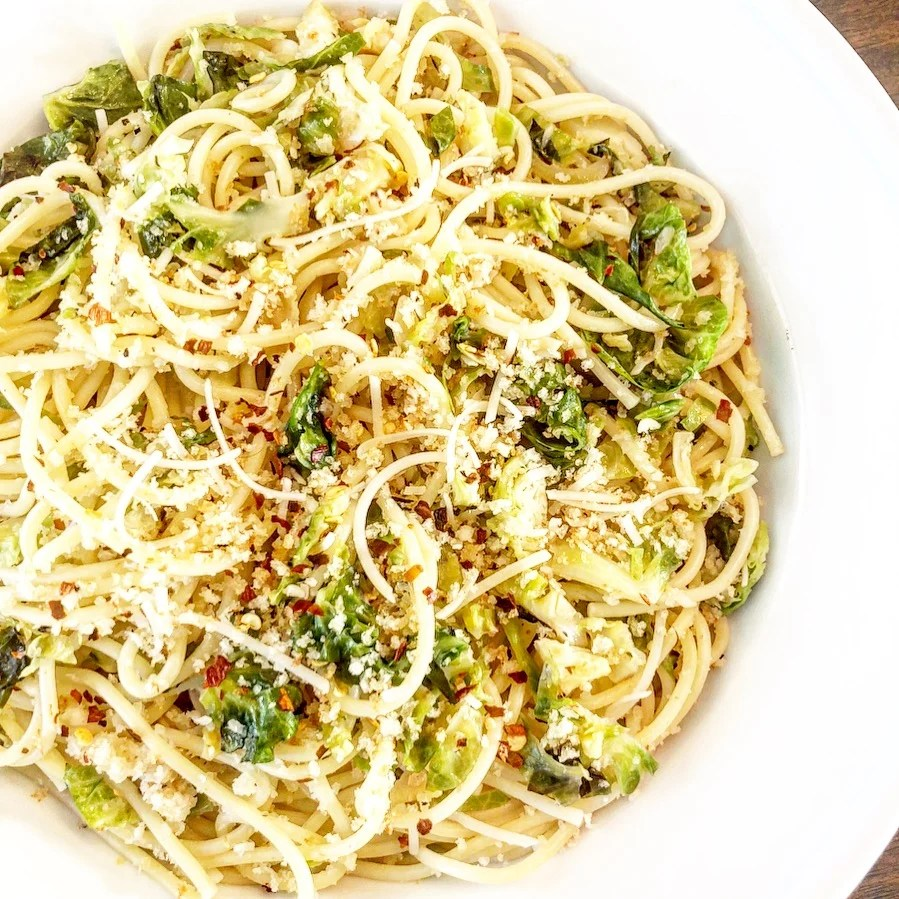 Spaghetti with Brussels Sprouts and Breadcrumbs | This company-worthy pasta dinner with in-season flavors of roasted Brussels sprouts and  lemony, toasted Panko breadcrumbs for a crisp, light touch on top is actually super easy to toss together.