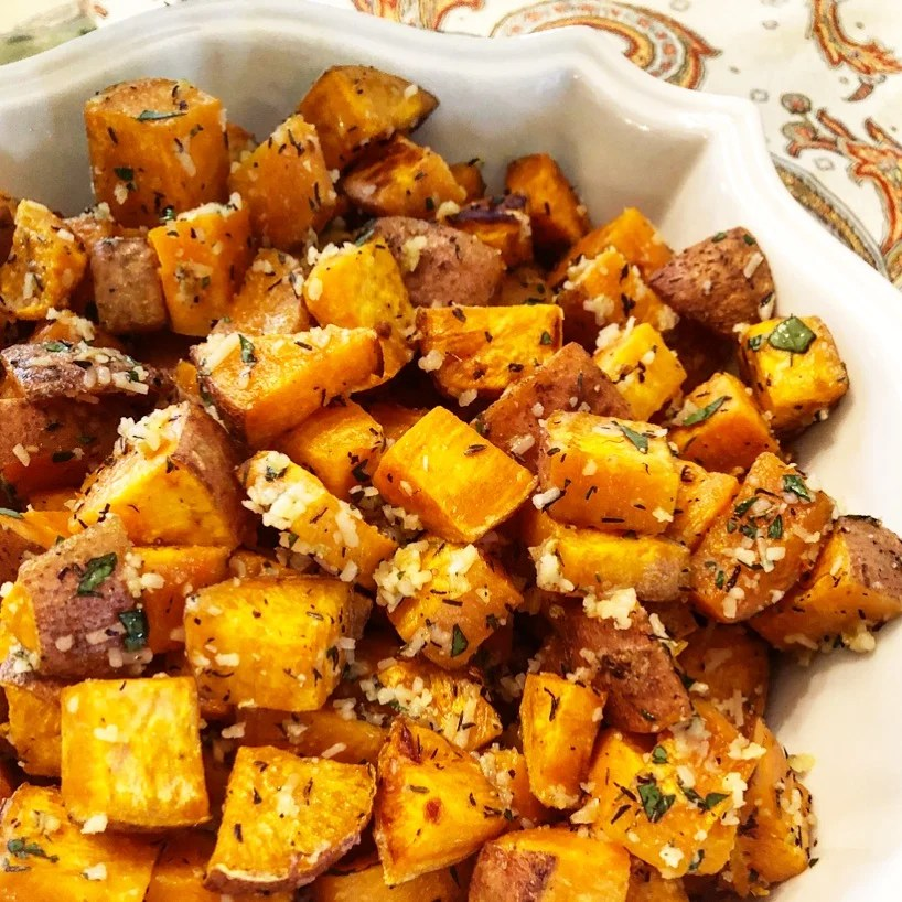 Holiday Roasted Sweet Potatoes | The irresistible flavor combination of sweet potatoes, garlic, herbs, parmesan make these potatoes perfect for the holiday table! | thiswifecooks.com