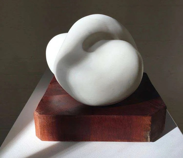 Carol Crawford. Alannah (2017), Carrara marble on a red gum base, 19cm H x 21cm W x 21cm D