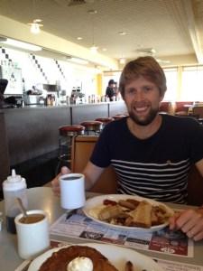 John enjoying a diner breakfast