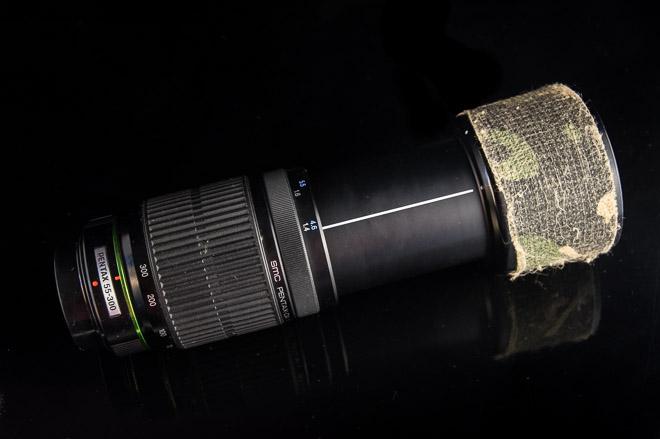 photographie d'un objectif 300mm camouflé
