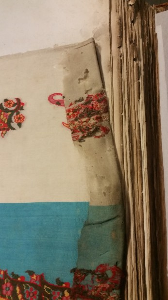 Image showing damage to textiles in a Board of Trade book