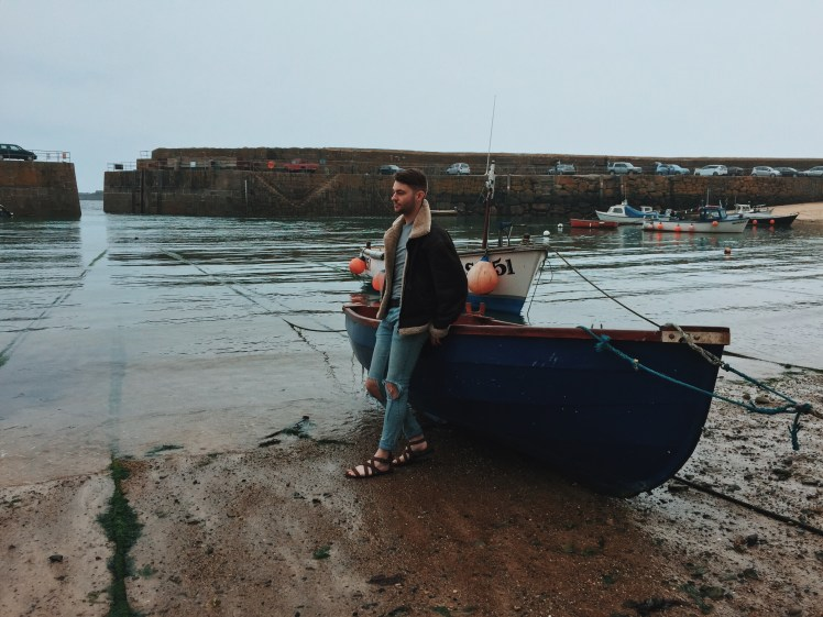 Tommy Next To Boat At Mousehole Fishing Port