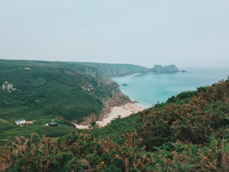 A glorous view overlooking the Cornish coast that we took from the road side. Below you can see the aquamarine waters, sandy beach and small houses that are present near the waters edge.