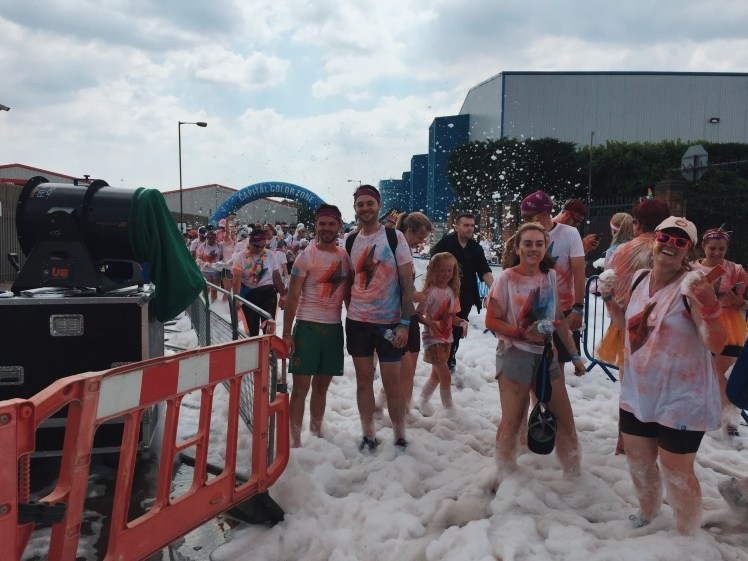 A shot taken by a random person of Jacob and myself [Tommy] at the foam gate checkpoint. It looks like a giant bubble bath has erupted all over the floor and covered people as they run through it.