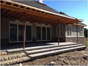 Natural flagstone on the rear covered porch, ready for columns and retractable screens!