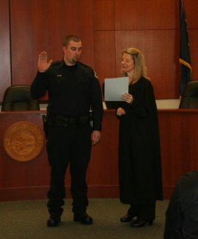 Reserve Officer Jordan Chase being sworn in