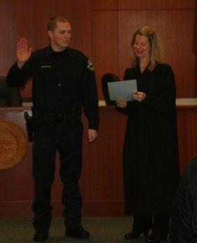 Reserve Officer Travis Schachtel being sworn in