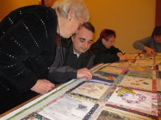 Being taught how to quilt