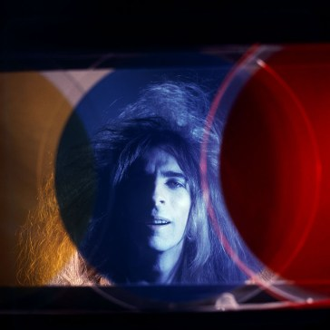 Rock star Alice Cooper (Vincent Furnier) poses for a portrait shot through a DeWain Valentine sculpture at a Venice art gallery on February 6, 1970 in Los Angeles, California.
