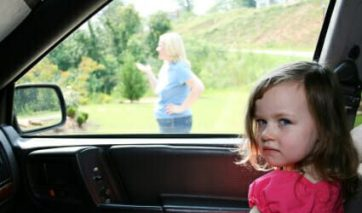 Child waiting in the car for mother