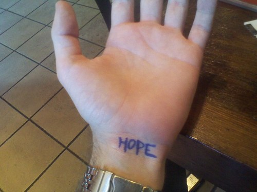 HOPE written on hand
