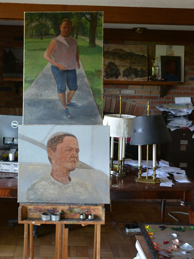 Two unfinished small paintings on the easel