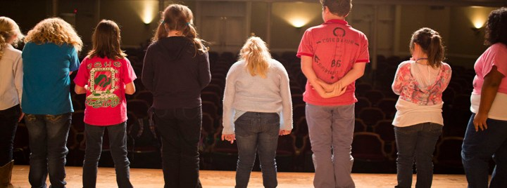theatre students lined up on stage