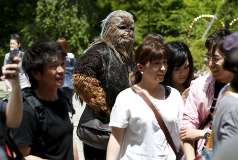 "Cosplayer dressed up as ""Star Wars"" character Chewbacca takes part in a Star Wars Day fan event in Tokyo"