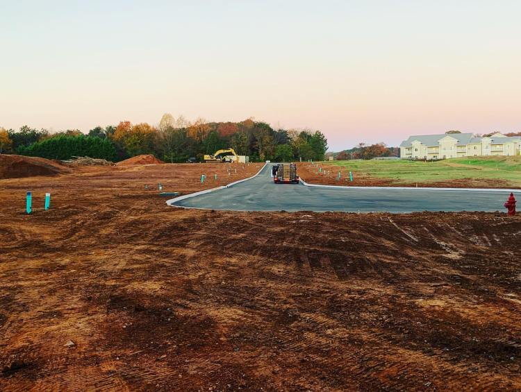 Seeding and mulching is a restorative form of erosion control. It makes the site look beautiful and prevents soil erosion by establishing roots and adding filtration on the surface through vegetation.