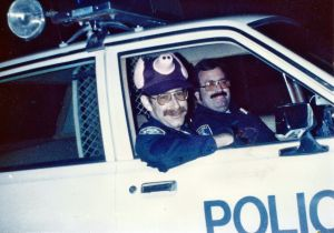Officer Gerry Goldshine (in the pig hat) and Reserve Officer Tim Aboudara behind the wheel-Halloween sometime in the 1980's