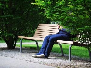 man sitting on park bench