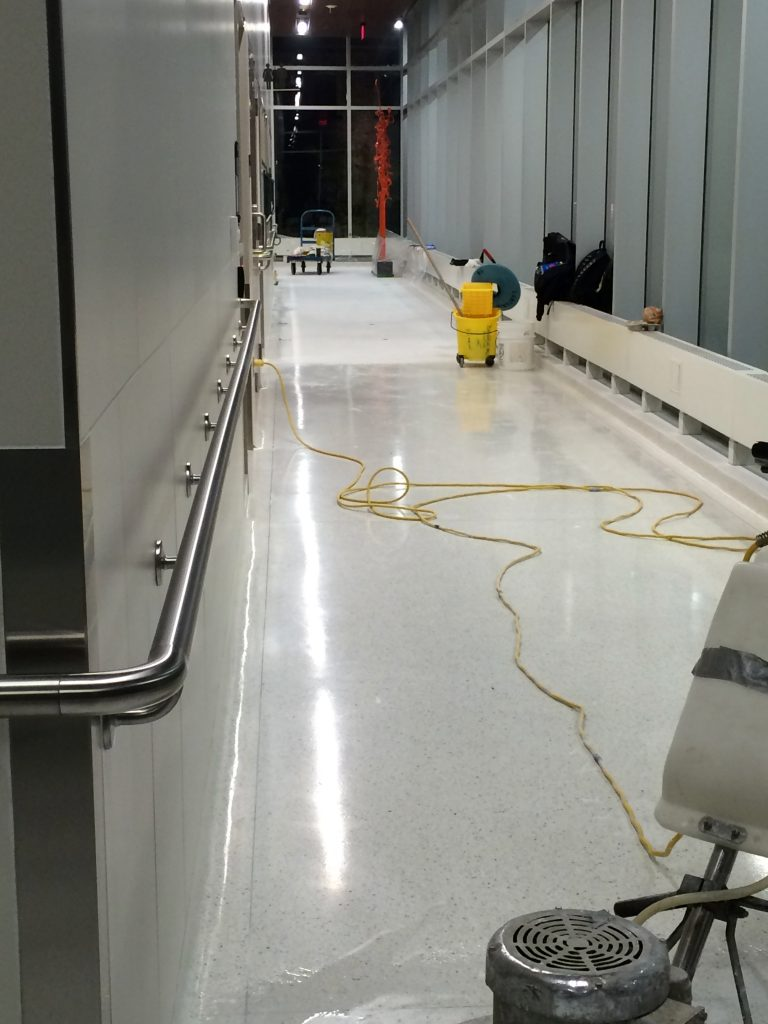 Thor & Partners restoration work on a marble floor of a building some cleaning equipment is shown in this picture