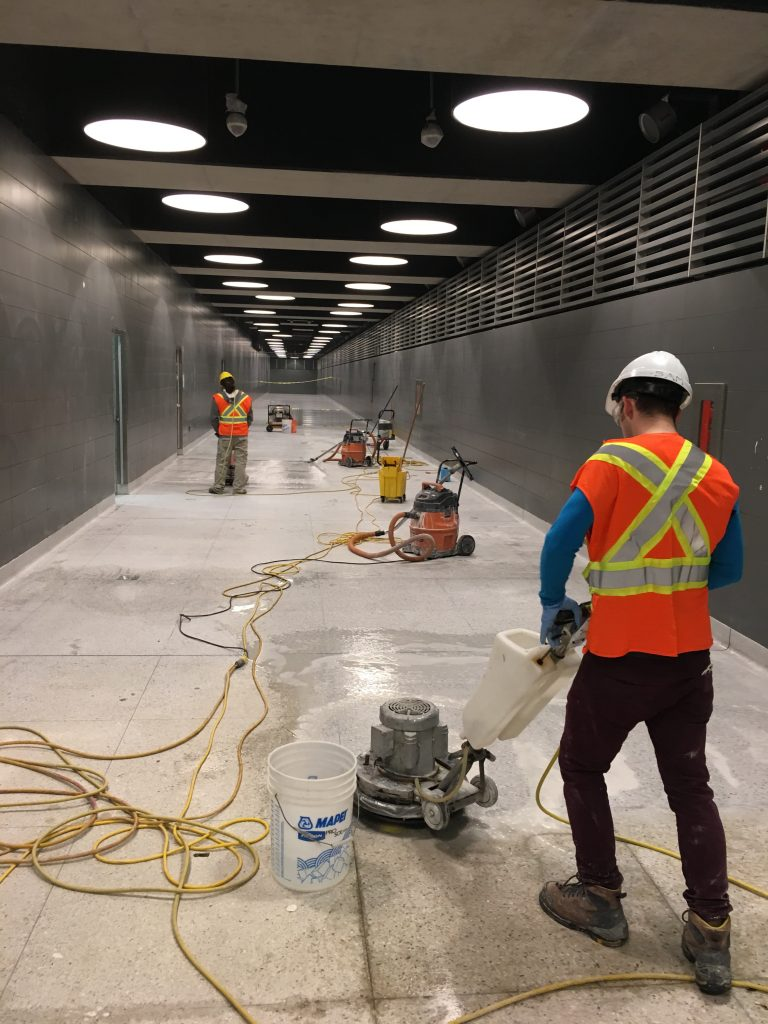 Thor & Partners restoration work on a floor of a building two people are wearing safety jackets