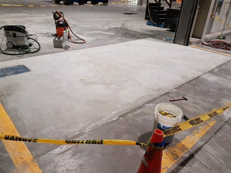 Thor and Partners . Concrete . CEMENTITIOUS OVERLAY SYSTEM . Working Done On Concrete Floor