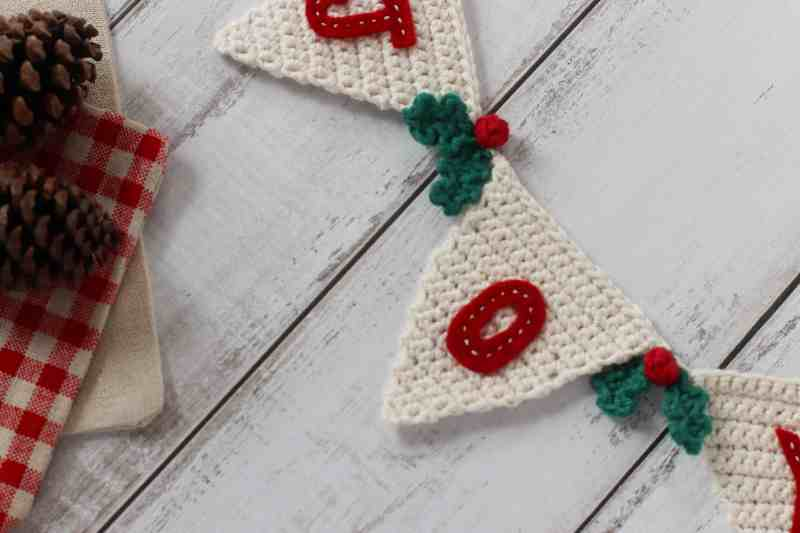 Crochet holly berries on Christmas bunting