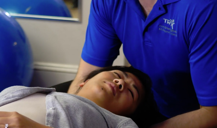 man receiving Chiropractor services nceck alignment at Richmondhill clinic