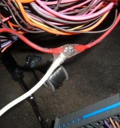 here we have a look at the jumper wire hanging out the side of the fuse box after reassembly  [ 2272 x 1704 Pixel ]