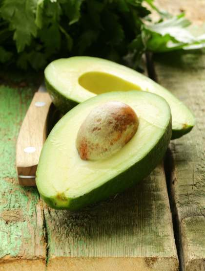 avocado-stone-skin-healthy-green-clean-good-fats-wooden-surface-knife