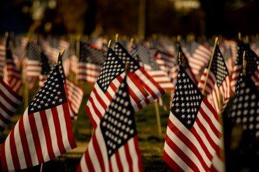 american-flags-grave-yard-sad-in-the-wind-blown-flying-stars-stripes
