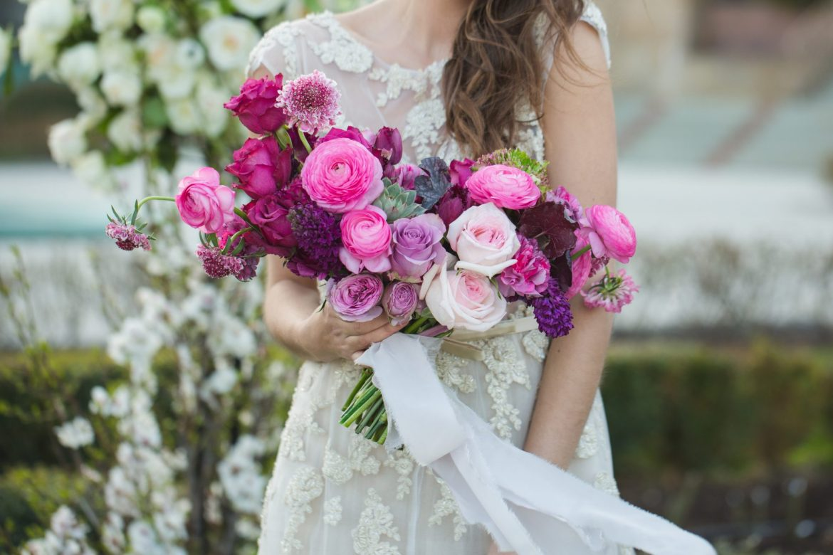 Bride-with-beautiful-wedding-bouquet-Pink-rose-and-other-flowers.