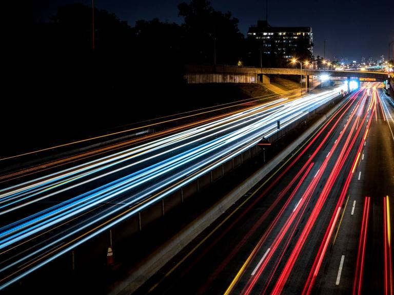 A time-lapsed picture of cars on a highway.