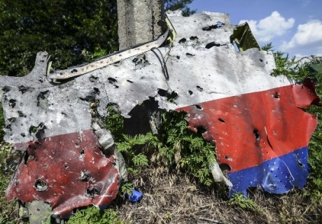 A part of the fuselage of the downed Malaysia Airlines flight MH17 is pictured in a field near the village of Grabove, in the Donetsk region, on July 23, 2014. The first bodies from flight MH17 arrived in the Netherlands on July 23 almost a week after it was shot down over Ukraine, with grieving relatives and the king and queen solemnly receiving the as yet unidentified victims. AFP PHOTO/ BULENT KILICBULENT KILIC/AFP/Getty Images